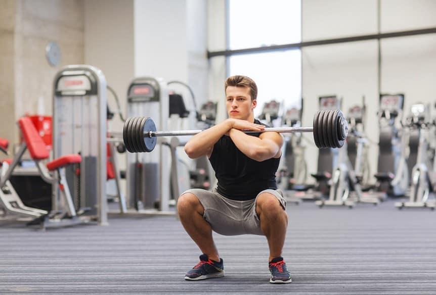 man performing a squat