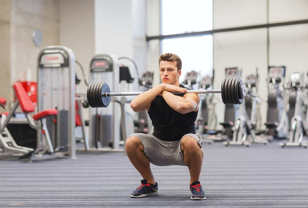 man performing a squat